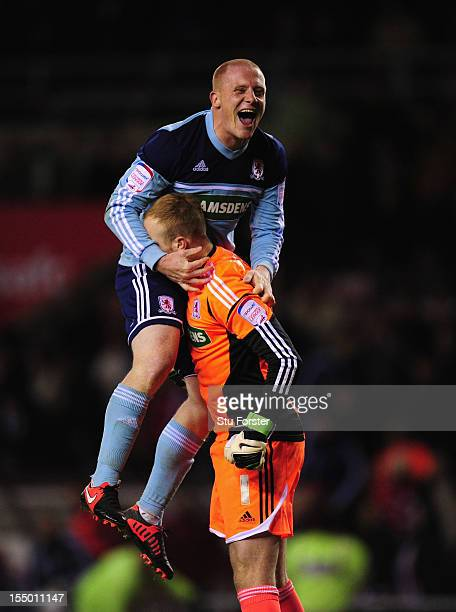 Middlesbrough player Nicky Bailey celebrates with keeper Jason Steele after the Capital One Cup Fourth Round match between Sunderland and...