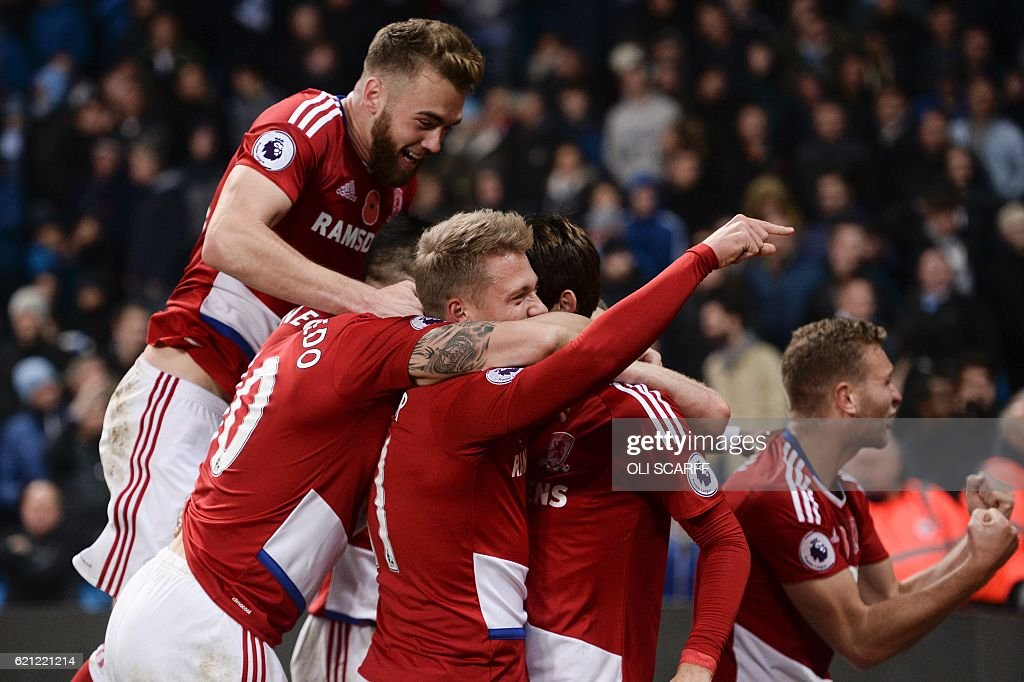 Middlesbrough players celebrate after Middlesbrough's Dutch midfielder Marten de Roon scored a late equalising goal for 1-1 during the English Premier League football match between Manchester City and Middlesbrough at the Etihad Stadium in Manchester, north west England, on November 5, 2016. / AFP / OLI SCARFF / RESTRICTED TO EDITORIAL USE. No use with unauthorized audio, video, data, fixture lists, club/league logos or 'live' services. Online in-match use limited to 75 images, no video emulation. No use in betting, games or single club/league/player publications. /