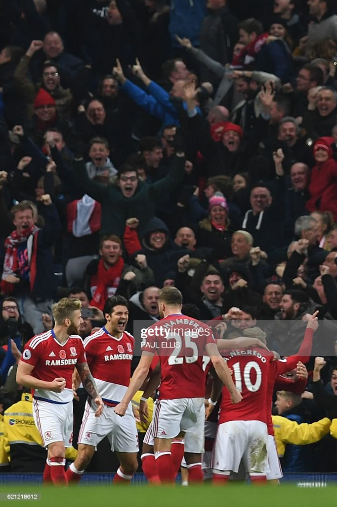 Middlesbrough players celebrate their late equalising goal for 1-1 during the English Premier League football match between Manchester City and Middlesbrough at the Etihad Stadium in Manchester, north west England, on November 5, 2016. / AFP / PAUL ELLIS / RESTRICTED TO EDITORIAL USE. No use with unauthorized audio, video, data, fixture lists, club/league logos or 'live' services. Online in-match use limited to 75 images, no video emulation. No use in betting, games or single club/league/player publications. /