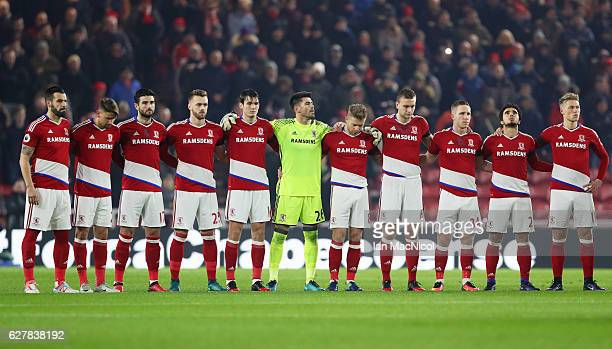 Middlesbrough players observe a minutes silence for the victims of the plane crash involving the Brazilian club Chapecoense prior to the Premier...