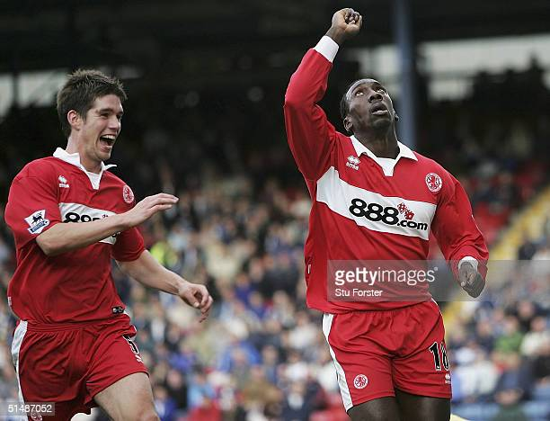 Middlesbrough striker Jimmy Floyd Hasselbaink celebrates with Chris Riggott after scoring his second goal during the FA Barclays Premiership match...