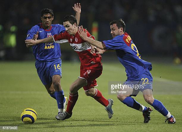 Middlesbrough winger Stewart Downing takes on Benel Nikolita and Sorin Paraschiv during the UEFA Cup semi final first leg between Steaua Bucharest...
