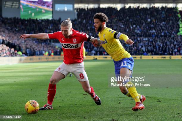 Middlesbrough's Adam Clayton and Leeds United's Tyler Roberts during the Sky Bet Championship match at The Riverside Stadium Middlesbrough