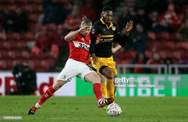 Middlesbrough's Adam Clayton and Newport County's Jamille Matt challenge during the FA Cup fourth round match at Riverside Stadium Middlesbrough