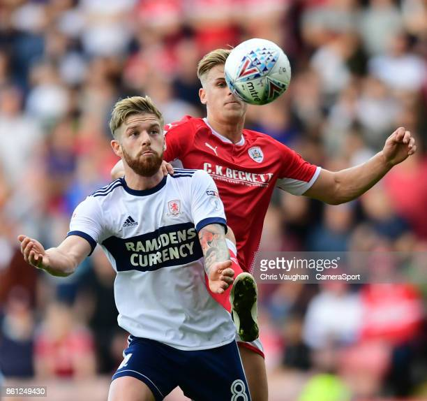 Middlesbrough's Adam Clayton vies for possession with Barnsley's Brad Potts during the Sky Bet Championship match between Barnsley and Middlesbrough...