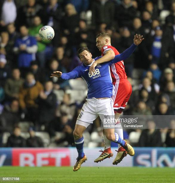 Middlesbrough's Adam Clinton jumps with Birmingham City's Lukas Jutkiewicz during the Sky Bet Championship match between Birmingham City and...