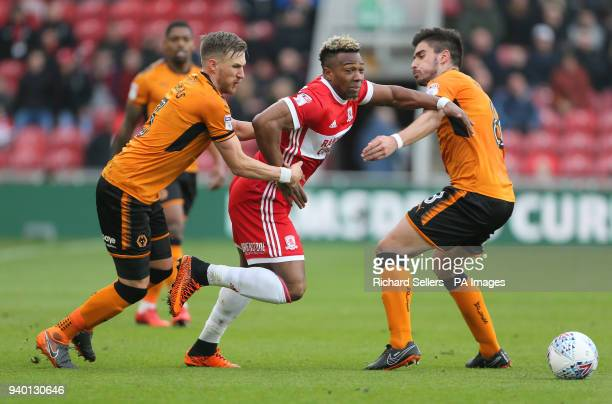 Middlesbrough's Adama Traore battles for the ball with Wolverhampton Wanderers' Barry Douglas and Wolverhampton Wanderers' Ruben Neves during the Sky...