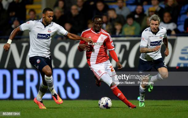 Middlesbrough's Albert Adomah battles for the ball with Bolton Wanderers Liam Trotter and Kevin McNaughton during the Sky Bet Championship match at...