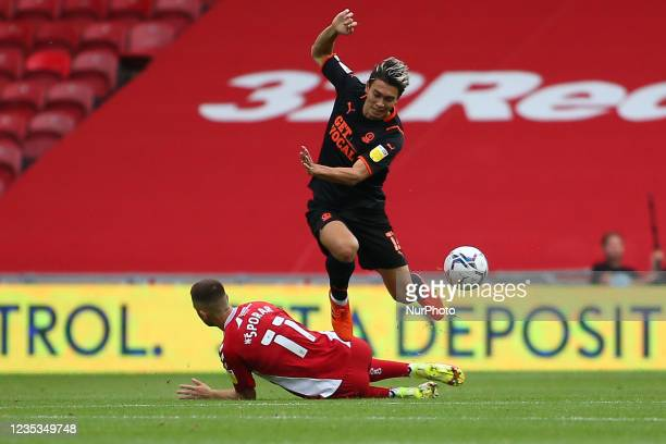Middlesbrough's Andra porar makes an important tackle on Blackpool's Kenny Dougall during the Sky Bet Championship match between Middlesbrough and...