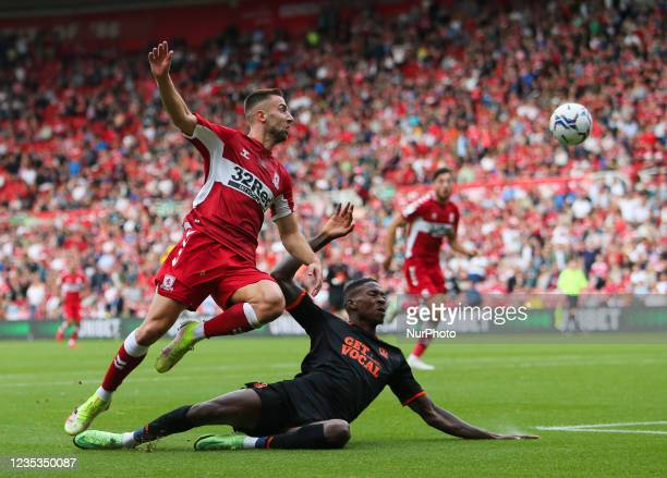 Middlesbrough's Andra porars shoots on goal despite pressure from the Blackpool defence during the Sky Bet Championship match between Middlesbrough...