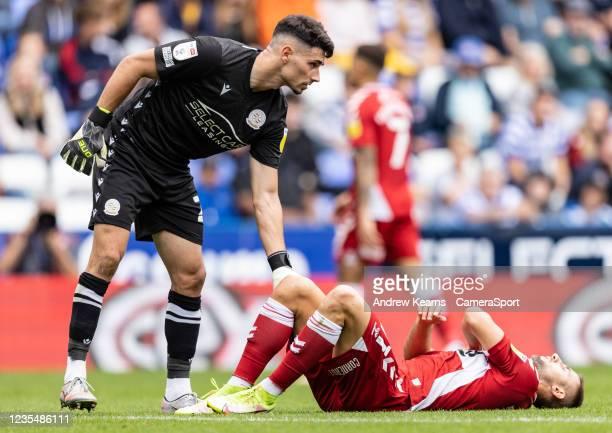 Middlesbrough's Andraz Sporar is checked on by Reading United's goalkeeper Luke Southwood after a collision during the Sky Bet Championship match...