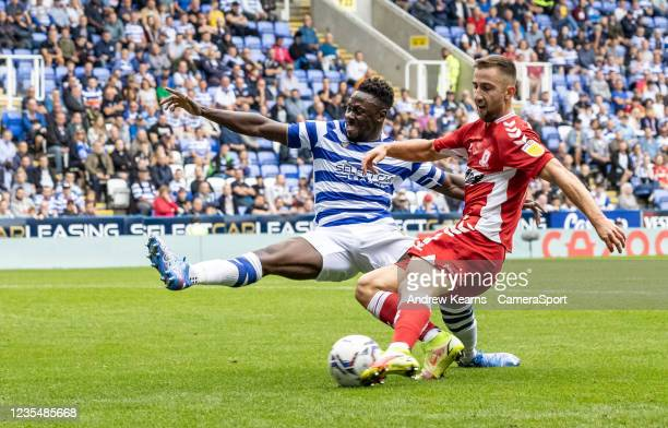 Middlesbrough's Andraz Sporar shoots at goal under pressure from Reading United's Andy Yiadomduring the Sky Bet Championship match between Reading...