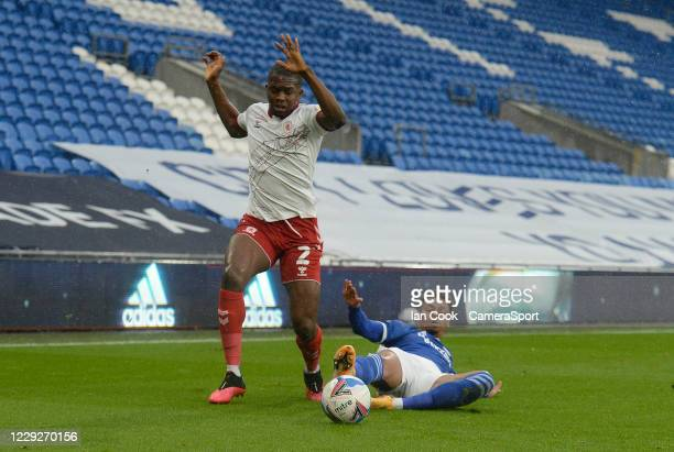 Middlesbrough's Anfernee Dijksteel battles with Cardiff City's Josh Murphy during the Sky Bet Championship match between Cardiff City and...
