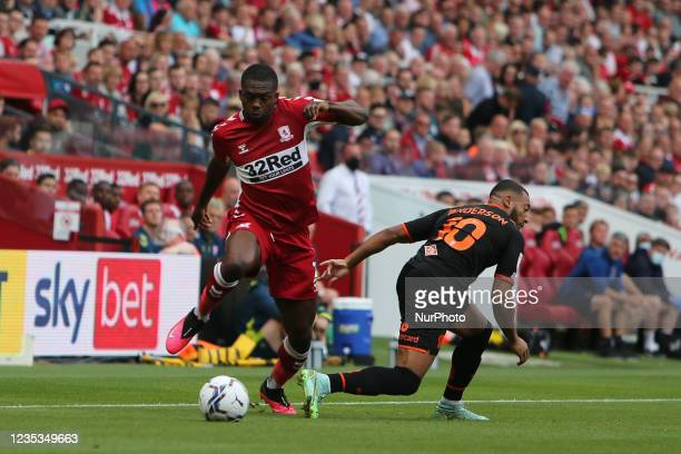 Middlesbrough's Anfernee Dijksteel goes past Blackpool's Keshi Anderson during the Sky Bet Championship match between Middlesbrough and Blackpool at...