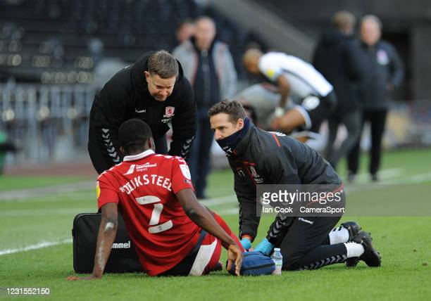 Middlesbrough's Anfernee Dijksteel is seen by the medical staff and is eventually taken odd injured during the Sky Bet Championship match between...
