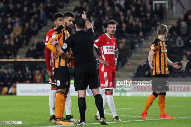 Middlesbrough's Ashley Fletcher and Marvin Johnson look on as Referee Tim Robinson sends of Hull City's Michael Hector during the Sky Bet...
