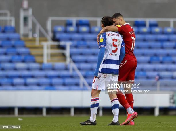 Middlesbrough's Ashley Fletcher embraces Reading's Tom McIntyre at the end of the match during the Sky Bet Championship match between Reading and...