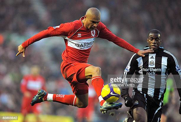 Middlesbrough's Brazilian forward Afonso Alves controls the ball in front of Newcastle United's Sebastien Bassong during the English Premier league...