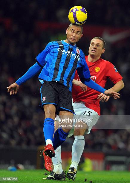 Middlesbrough's Brazilian forward Afonso Alves controls the ball infront of Manchester United's Serbian defender Nemanja Vidic during the English...