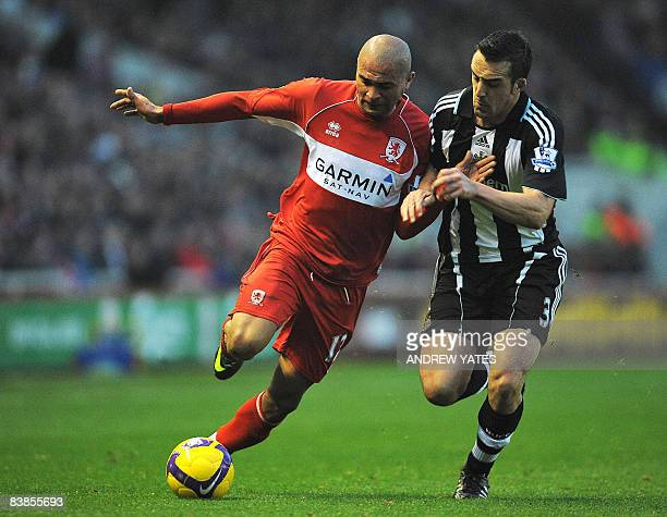 Middlesbrough's Brazilian forward Afonso Alves vies with Newcastle United's Spanish defender Sanchez Jose Enrique during the English Premier league...