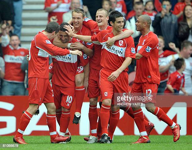 Middlesbrough's Brazilian midfielder Fabio Rochemback celebrates with team mates after scoring during the English Premier league football match...