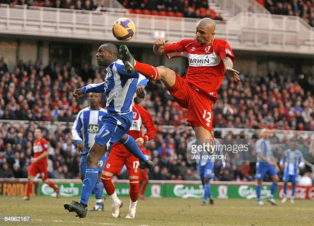 Middlesbrough's Brazilian player Afonso Alves challenges for the ball against Wigan Athletic's Barbados footballer Emmerson Boyce during their...