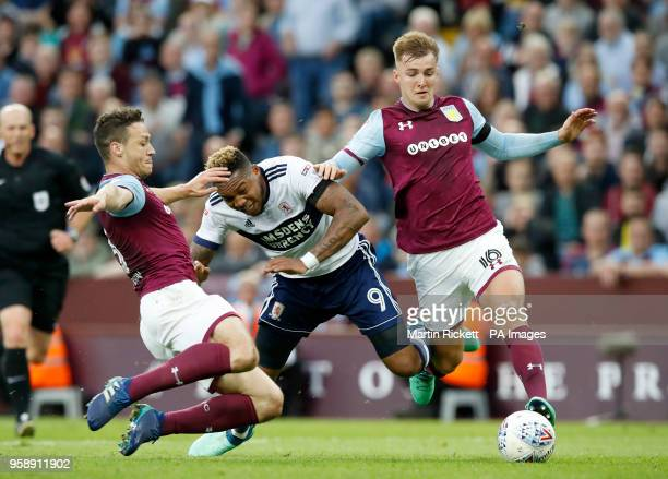Middlesbrough's Britt Assombalonga and Aston Villa's James Bree and James Chester during the Sky Bet Championship Playoff match at Villa Park...