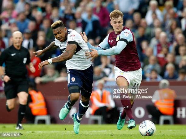 Middlesbrough's Britt Assombalonga and Aston Villa's James Bree during the Sky Bet Championship Playoff match at Villa Park Birmingham