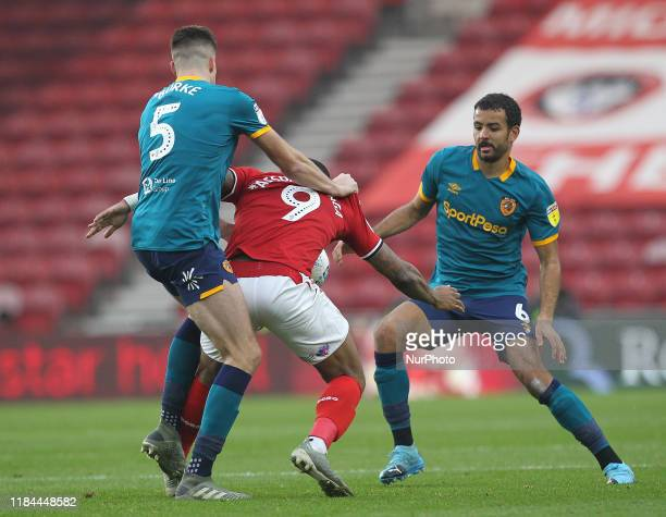 Middlesbrough's Britt Assombalonga battles with Reece Burke and Kevin Stewart of Hull City during the Sky Bet Championship match between...