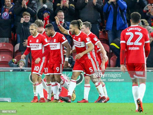 Middlesbrough's Britt Assombalonga celebrates scoring his side's second goal with teammates during the Sky Bet Championship match between...