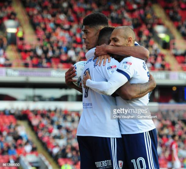 Middlesbrough's Britt Assombalonga centre celebrates scoring his sides second goal with teammates Ashley Fletcher left and Martin Braithwaite during...