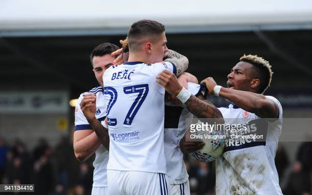 Middlesbrough's Britt Assombalonga centre celebrates scoring his sides equalising goal to make the score 11 with teammate Muhamed Besic and Adama...
