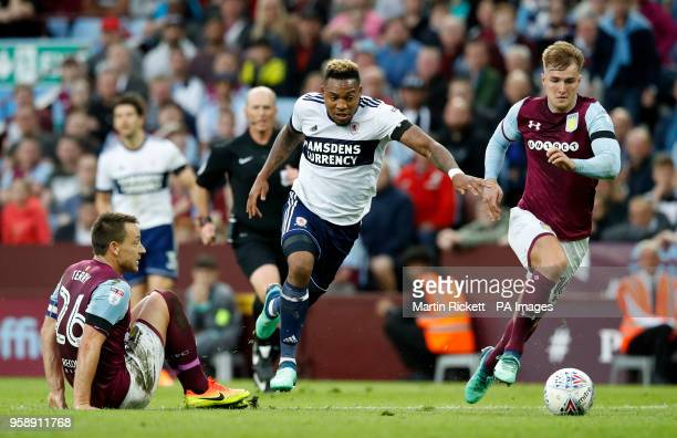 Middlesbrough's Britt Assombalonga gets away from Aston Villa's John Terry and James Bree during the Sky Bet Championship Playoff match at Villa Park...