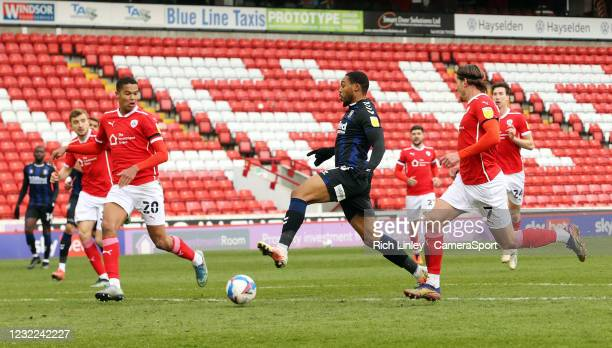 Middlesbrough's Britt Assombalonga looks to control under pressure from Barnsley's Toby Sibbick and Callum Brittain during the Sky Bet Championship...