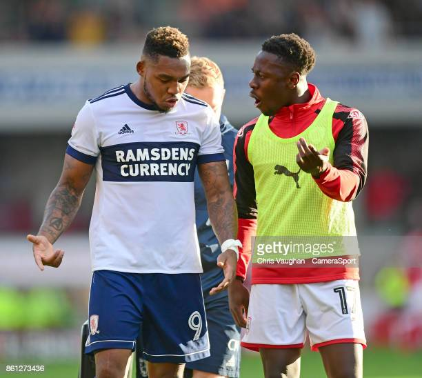 Middlesbrough's Britt Assombalonga speaks to Barnsley's Andy Yiadom as they walk off the pitch following the Sky Bet Championship match between...