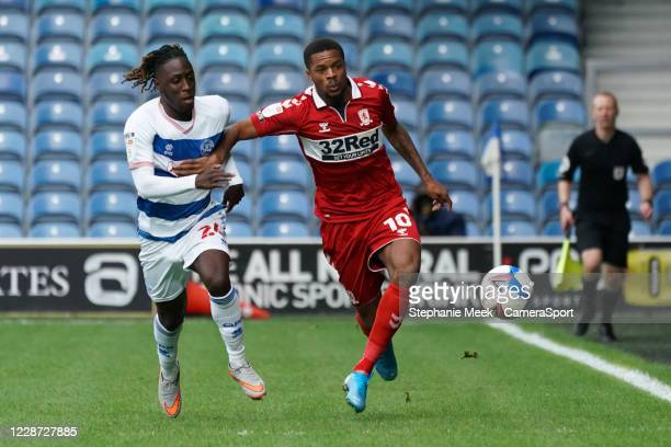 Middlesbrough's Chuba Akpom battles for possession with Queens Park Rangers' Osman Kakay during the Sky Bet Championship match between Queens Park...