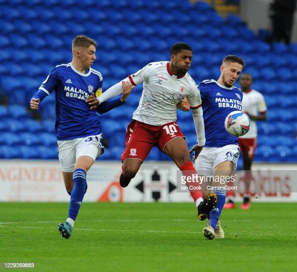 Middlesbrough's Chuba Akpom battles with Cardiff City's Will Vaulks and Joel Bagan during the Sky Bet Championship match between Cardiff City and...