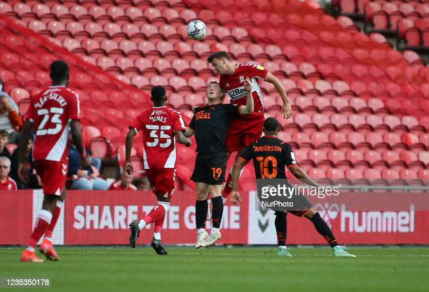 Middlesbrough's Dael Fry outjumps Blackpool's Shayne Lavery during the Sky Bet Championship match between Middlesbrough and Blackpool at the...