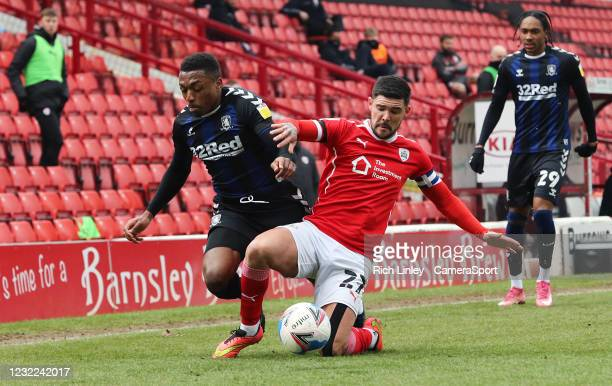 Middlesbrough's Darnell Fisher is fouled by Barnsley's Alex Mowatt during the Sky Bet Championship match between Barnsley and Middlesbrough at...