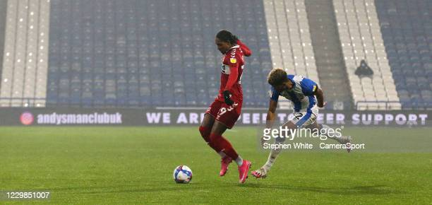 Middlesbrough's Djed Spence shields the ball from Huddersfield Town's Fraizer Campbell during the Sky Bet Championship match between Huddersfield...