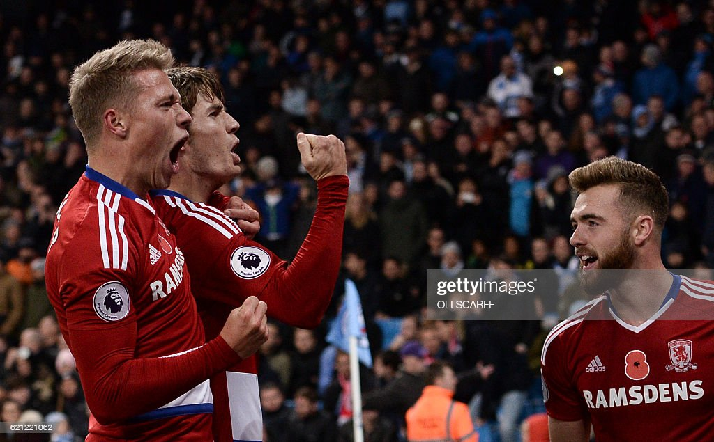 Middlesbrough's Dutch midfielder Marten de Roon (2L) and team-mates celebrate scoring a late equalising goal for 1-1 during the English Premier League football match between Manchester City and Middlesbrough at the Etihad Stadium in Manchester, north west England, on November 5, 2016. / AFP / OLI SCARFF / RESTRICTED TO EDITORIAL USE. No use with unauthorized audio, video, data, fixture lists, club/league logos or 'live' services. Online in-match use limited to 75 images, no video emulation. No use in betting, games or single club/league/player publications. /