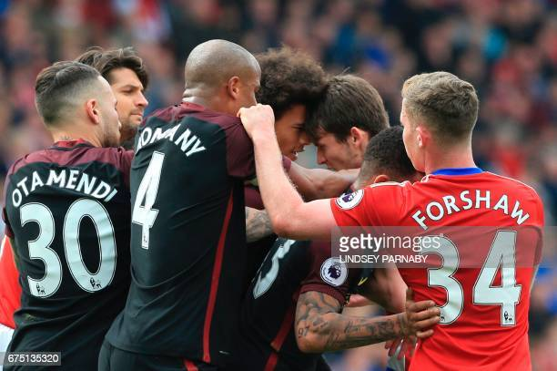 Middlesbrough's Dutch midfielder Marten de Roon clashes with Manchester City's German midfielder Leroy Sane during the English Premier League...