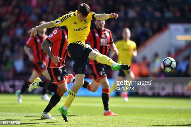 Middlesbrough's Dutch midfielder Marten de Roon has a shot on goal during the English Premier League football match between Bournemouth and...