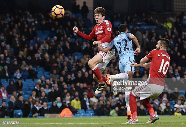 Middlesbrough's Dutch midfielder Marten de Roon heads the ball in to score a late equalising goal for 11 during the English Premier League football...