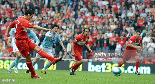 Middlesbrough's English forward Stewart Downing scores from the penalty spot during the English Premier league football match against Manchester City...