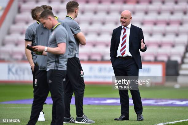 Middlesbrough's English head coach Steve Agnew talks to his players before the English Premier League football match between Bournemouth and...