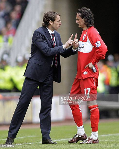 Middlesbrough's English manager Gareth Southgate instructs his Turkish player Tuncay Sanli during the English Premier League football match between...