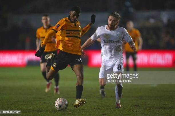 Middlesbrough's English midfielder Adam Clayton reacts as Newport County's English midfielder Tyreeq Bakinson shoots but fails to score during the...