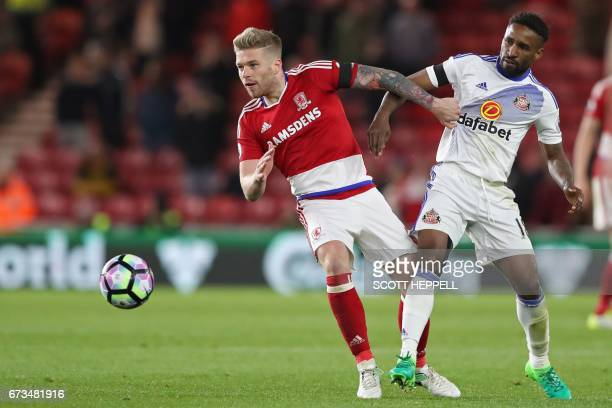 Middlesbrough's English midfielder Adam Clayton vies with Sunderland's English striker Jermain Defoe during the English Premier League football match...