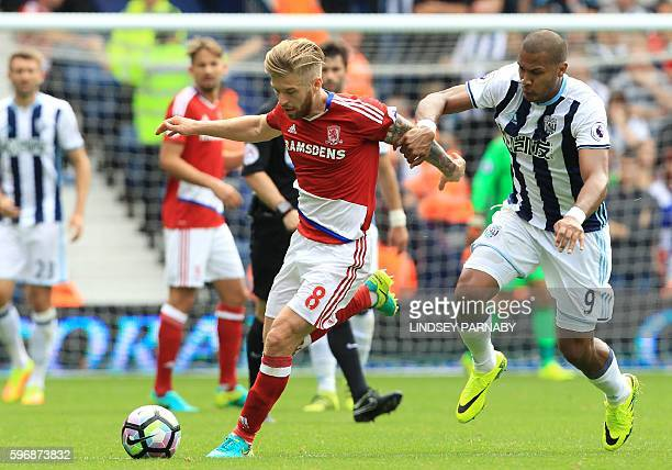 Middlesbrough's English midfielder Adam Clayton vies with West Bromwich Albion's Venezuelan striker Salomon Rondon during the English Premier League...